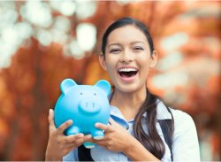 a woman holding piggy bank